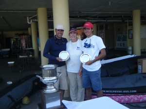 Susan Walcutt presenting trophies to the Aicardi Fleet winner, Andre and Roberto Guaragna
