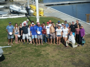 Group photo (at the flagpole) of some of the participants in the 2013 Comodoro Rasco Snipe Regatta